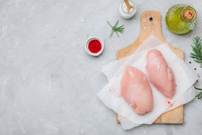 Raw chicken breast fillets with rosemary, red paprika and spices