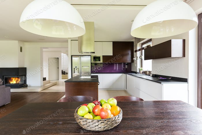 Dark wooden table in stylish house