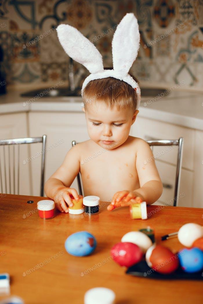 Little boy sitting in a kitchen