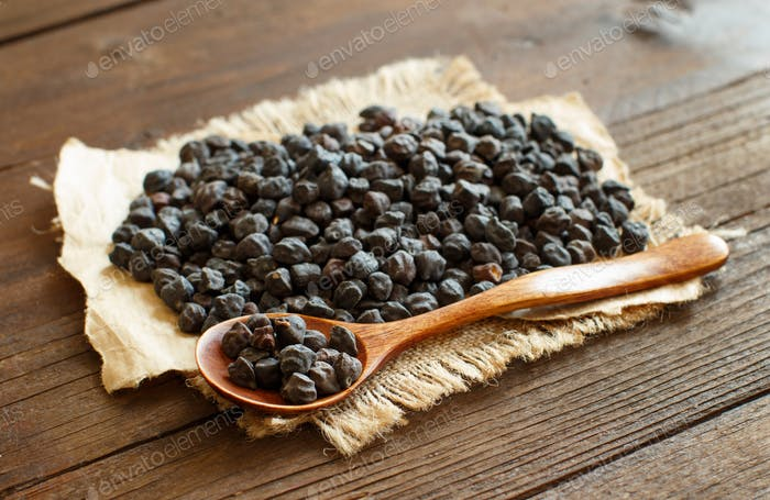 Black Chickpea with a spoon on a wooden table