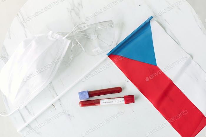 Coronavirus testing sample and Czech flag are on the table