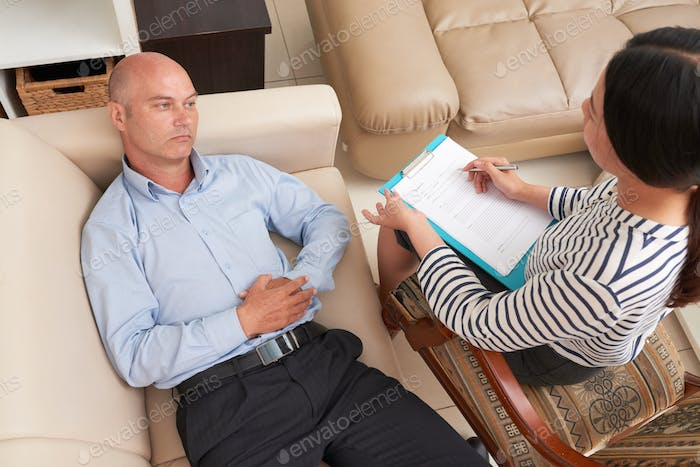 Psychologist working with patient