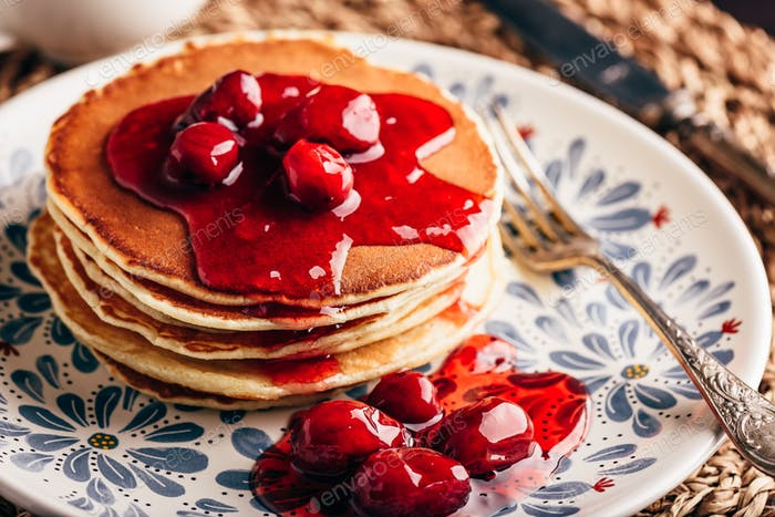 Stack of pancakes with dogwood berry marmalade