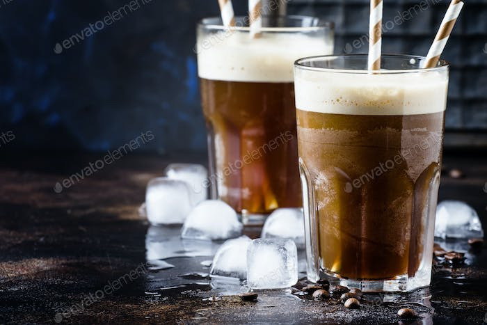 Cold frappe coffee with ice and foam in large glasses