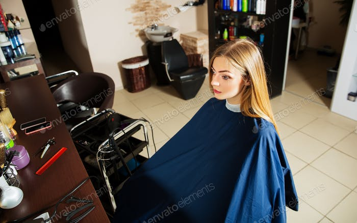Girl waiting for hairdresser in hairdressing salon