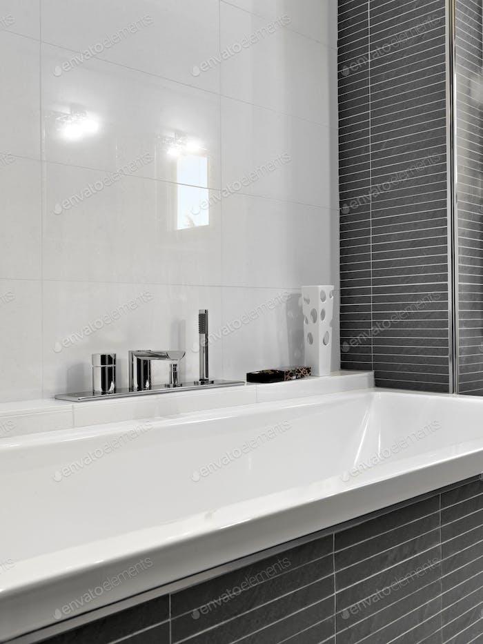 CloseUp on the Bathtub in the ModernBathroom