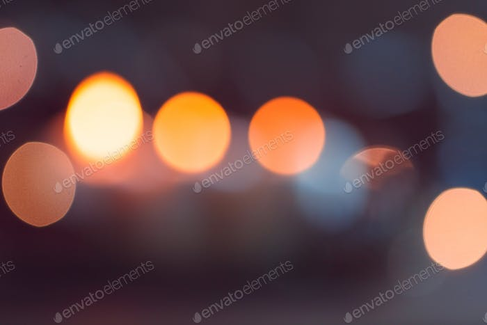 Blurred lights at night. Abstract circular bokeh background.