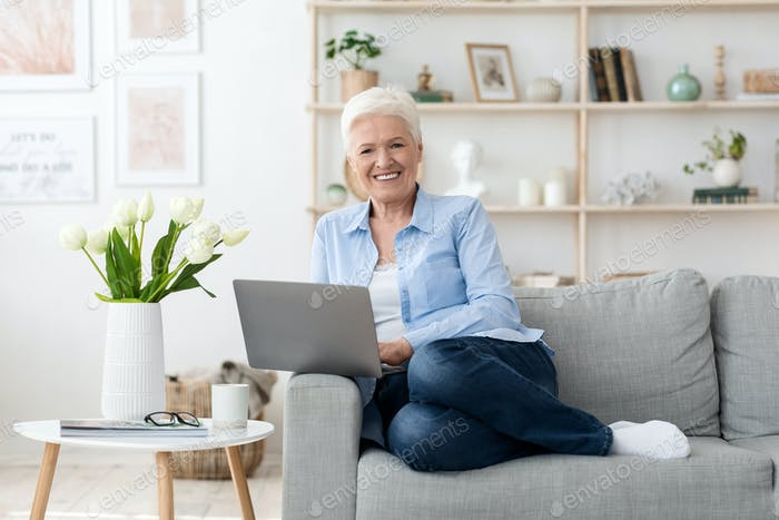 Freelance Jobs For Seniors. Happy Elderly Lady Using Laptop Computer At Home