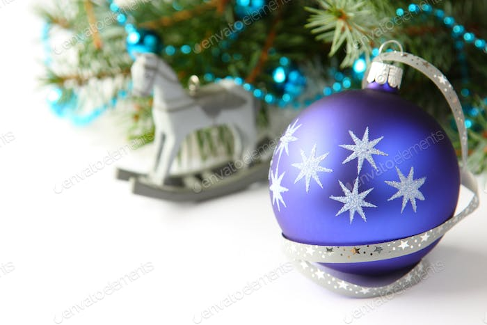 Christmas composition with blue ball and decoration over white