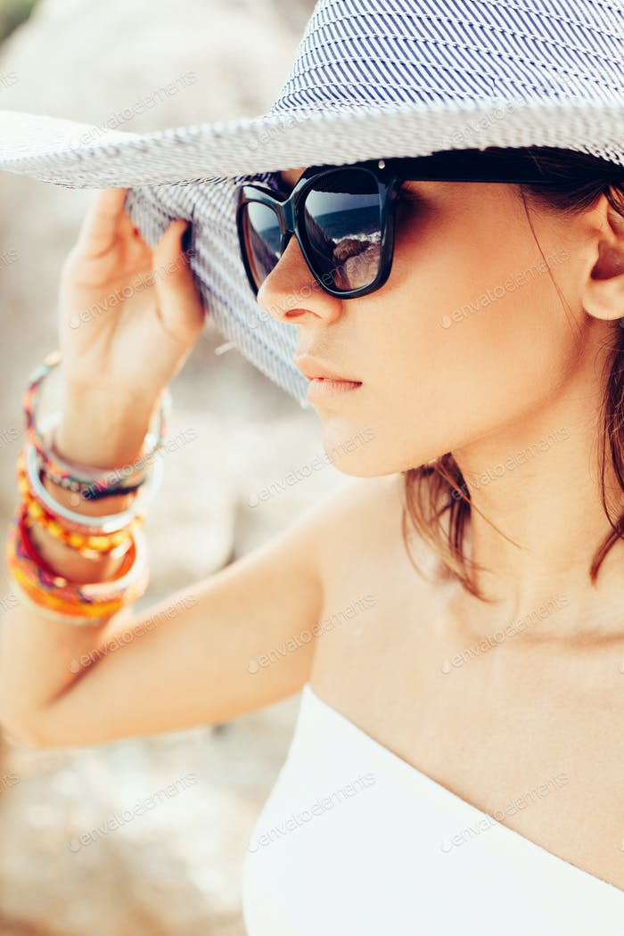 young summer girl wearing hat  and sunglasses