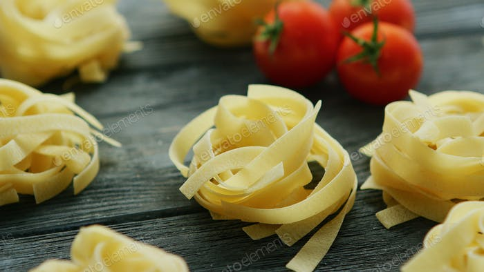Spaghetti in shape of balls with tomatoes