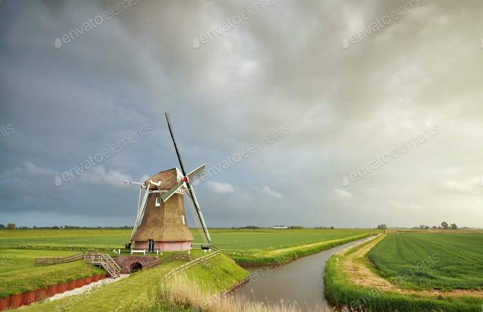rainy sky over Dutch windmill