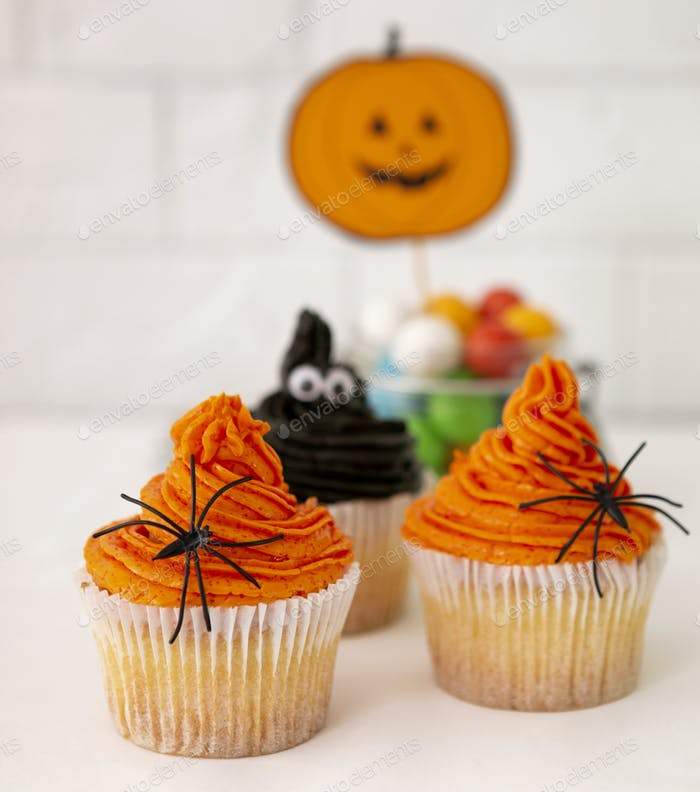 Close up of sweet and creative cakes with pumpkin cream
