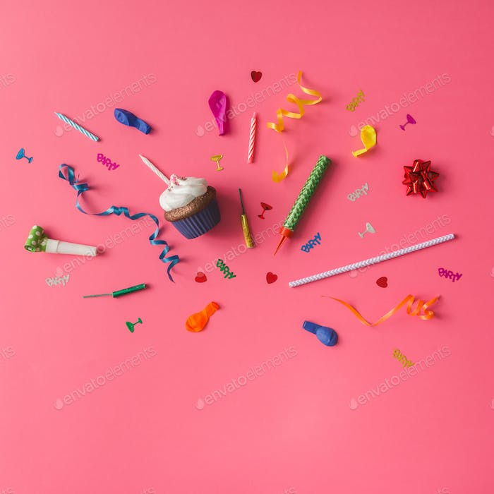 Colorful party items on pink background. Flat lay.