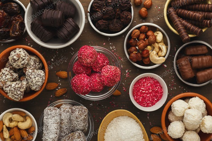 Wooden desktop with assortment of healthy sweets and nuts