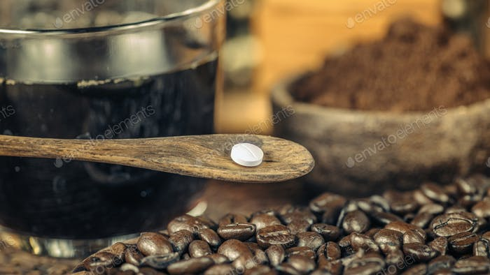 Caffeine Supplement Pill and Coffee Beans