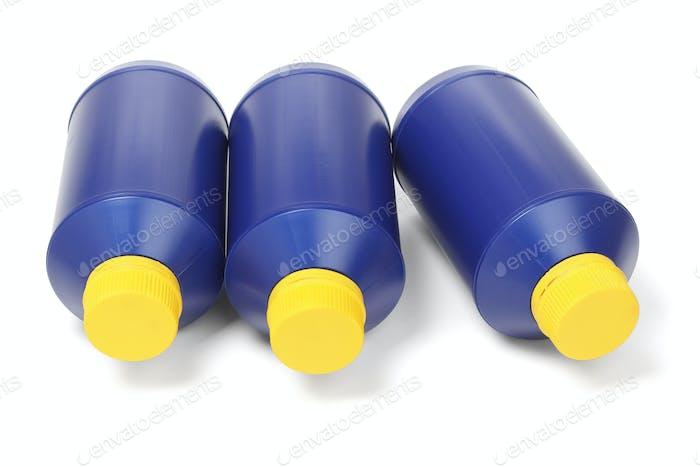 Three Blue Plastic Bottles