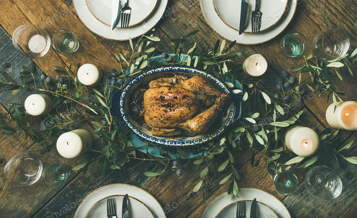 Holiday table setting for party, gathering or celebration roast chicken