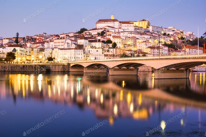 View Of Coimbra In Portugal And Mondego River At Night