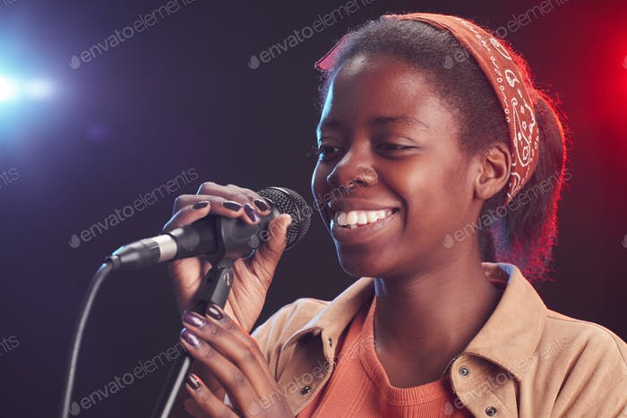 Young African-American Woman Singing to Microphone