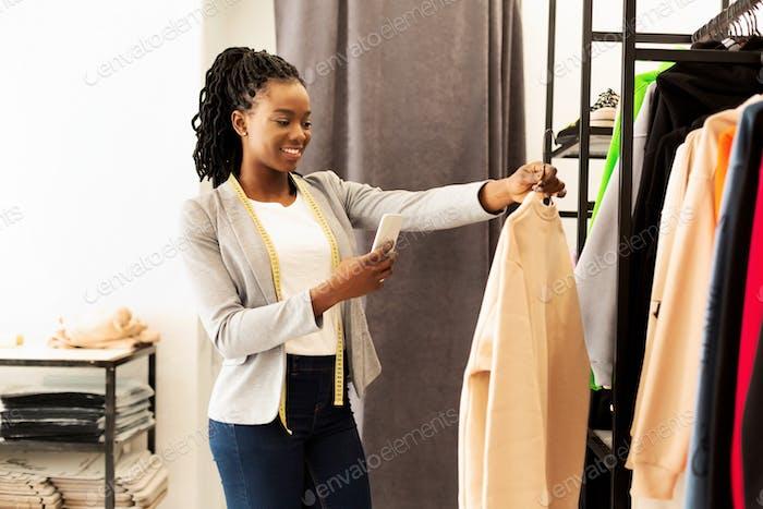 Professional Afro Designer Taking Photo Of New Garment In Studio