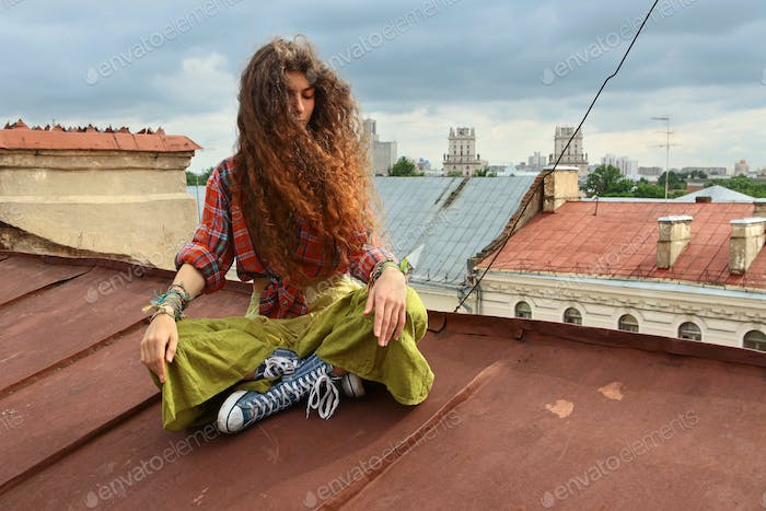 Girl on a roof
