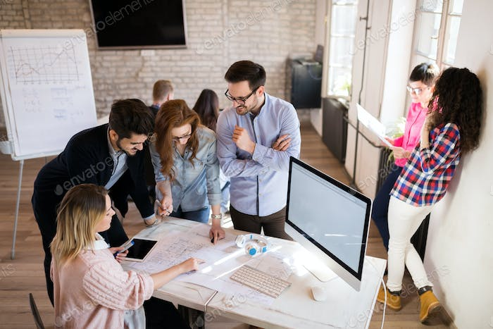 Picture of young architects discussing in office