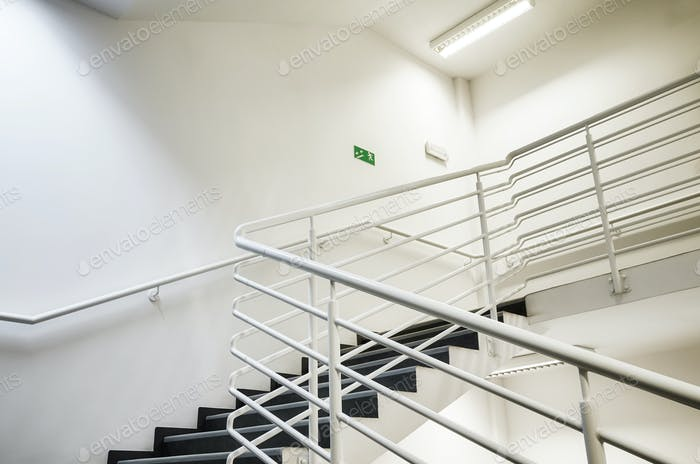Modern empty staircase with white wall.
