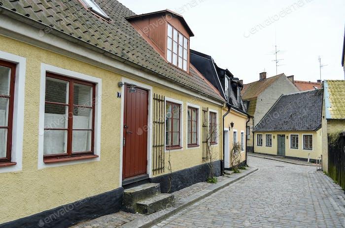 Exterior of single-storey residential building on a cobbled street in Copenhagen, Denmark.