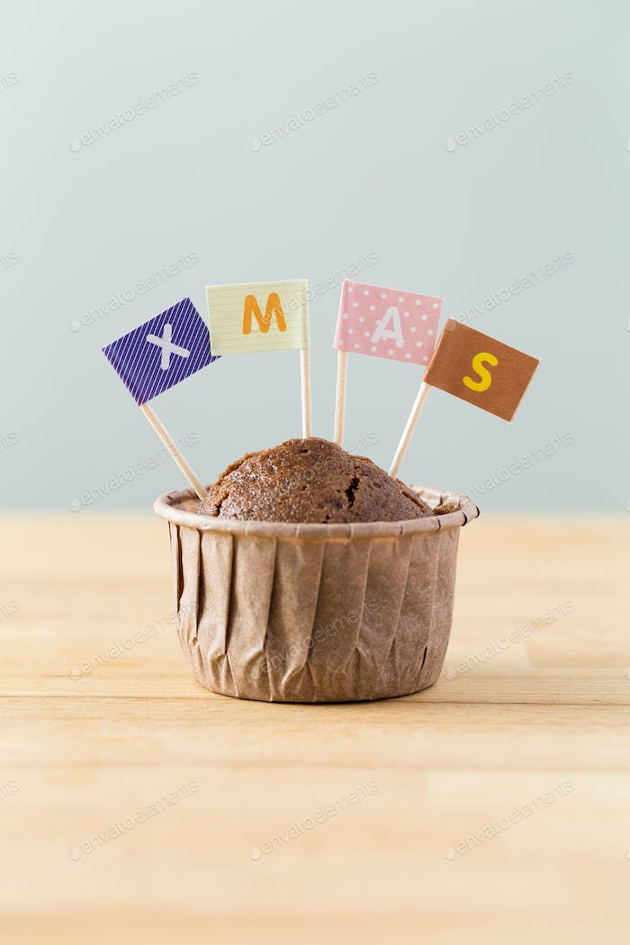 Chocolate muffins with small flag of a x mas
