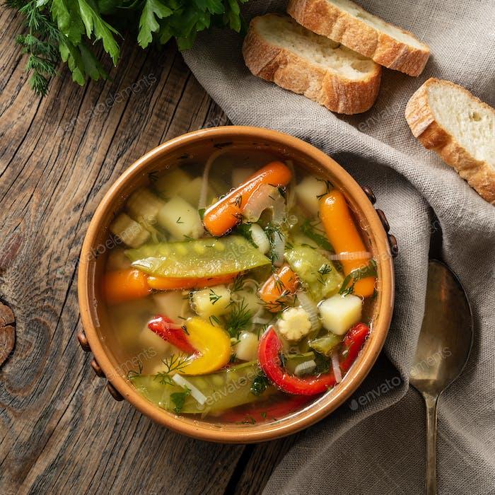 Bright spring vegetable dietary vegetarian soup.