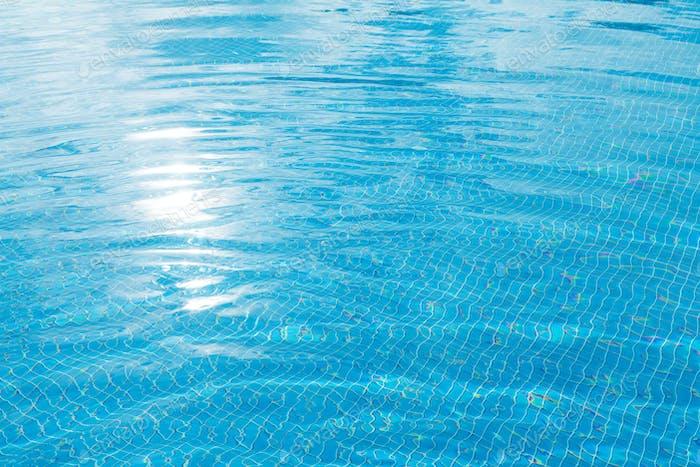 Sunny swimming pool in tropical resort