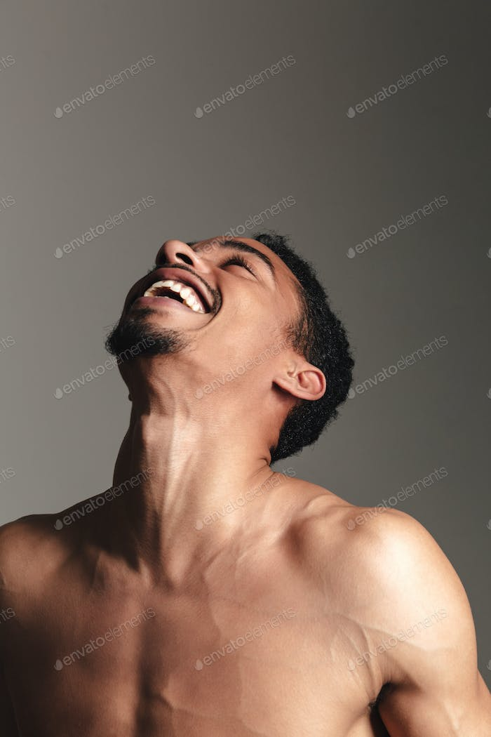Young laughing african man isolated