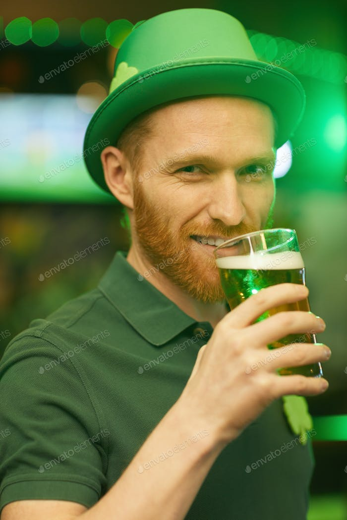 Man with beer in the pub