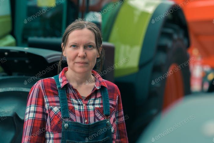 Female farmer and agricultural tractor