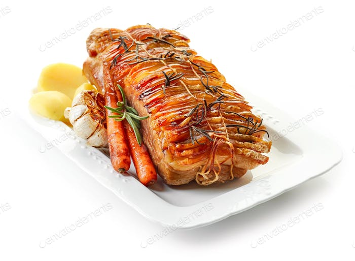 roasted pork and vegetables on white plate