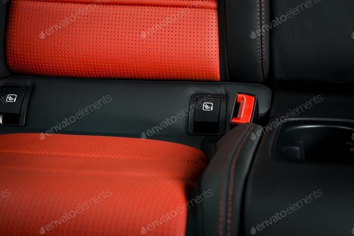 Modern race car  black and red perforated leather interior.