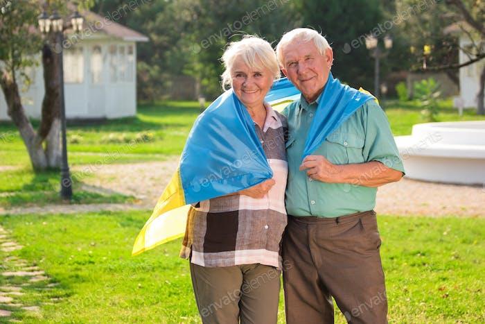Elderly couple with Ukrainian flag