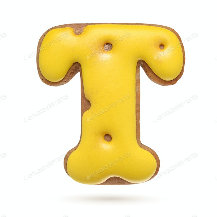 Capital letter T yellow gingerbread biscuit isolated on white.