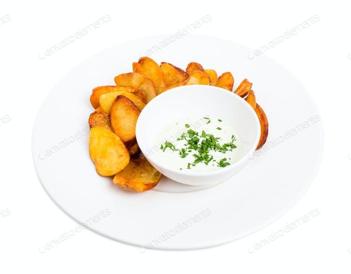 Roast potato wedges with tartar sauce.
