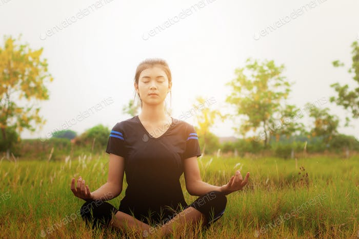 Girl is sitting on grass