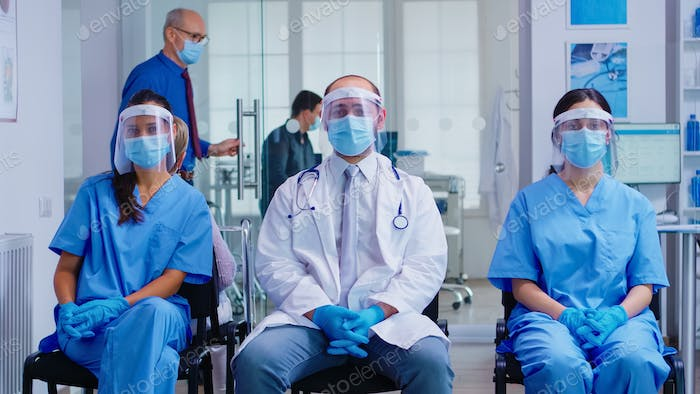 Team of medical staff with protection mask and visor