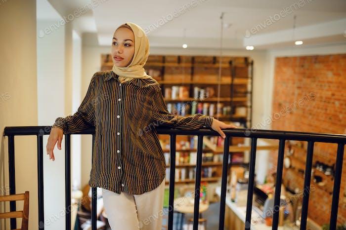 Beautiful arab girl in hijab in university cafe