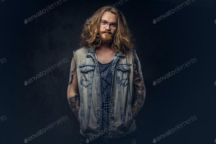 Redhead hipster male in a studio