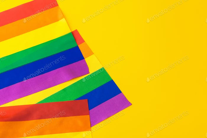 Bright rainbow gay flag, top view with space for text