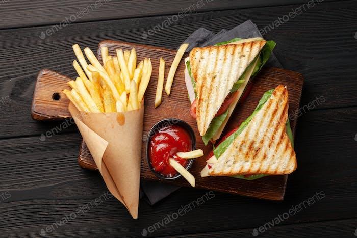 Potato fries and club sandwich