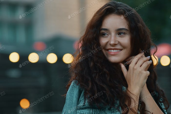 Beautiful female face with lights in background