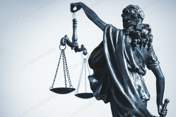Cropped view of statue of Justice with the scales