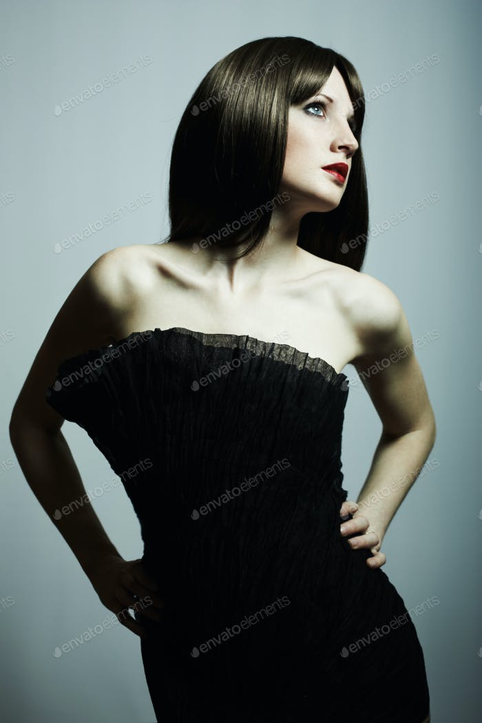 Fashion portrait of young beautiful elegant woman in the black