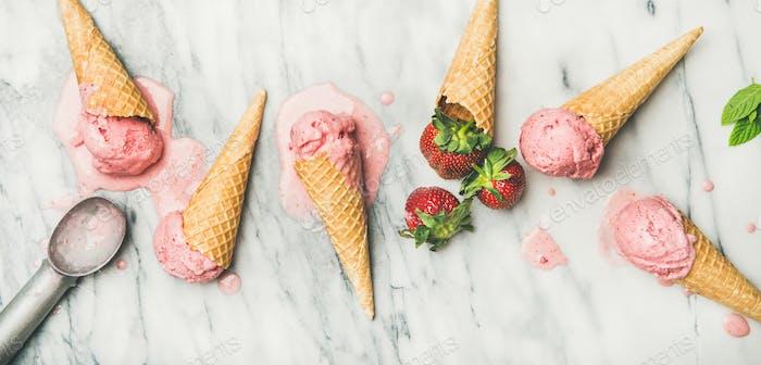 Flat-lay of homemade yogurt strawberry ice cream over marble background